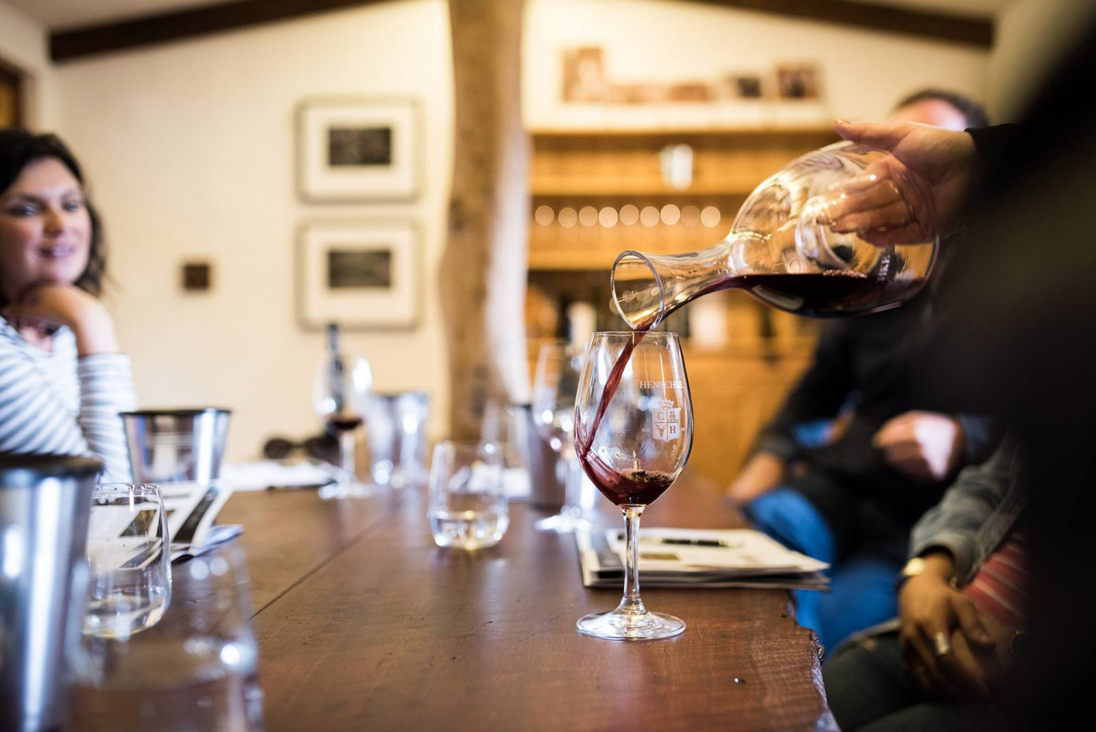 A carafe of red wine pouring into a glass at Henschke's Cellar Door